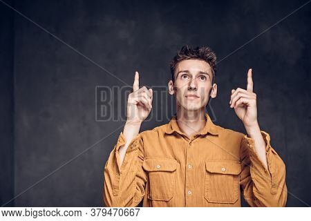 Young Caucasian Man Have Idea On Grey Dark Background With Copy Space