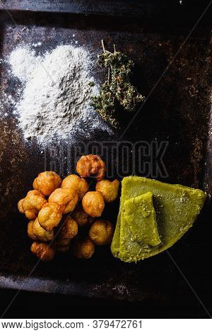 Churros Balls Spanish Donuts From Medical Cannabis Butter, Sugar, Flour, Egg. Nearby Are Marijuana B