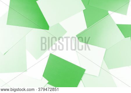Background Of Green Paper Sheets. Many Sheets Of Green Paper