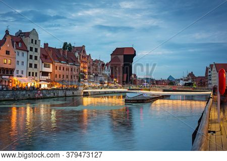 Gdansk, Poland - August 2, 2020: Amazing architecture of Gdansk old town at dusk with a new footbridge over the Motlawa River. Poland