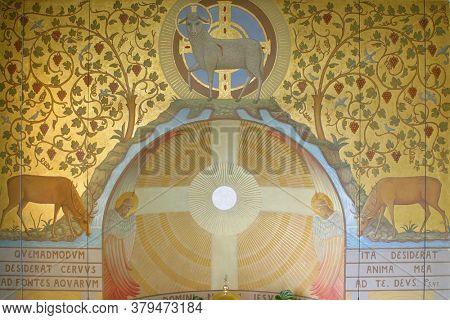 ZAGREB, CROATIA - NOVEMBER 26, 2014: Lamb of God, Agnus Dei with a cross, fresco in the church of Corpus Domini in Zagreb, Croatia