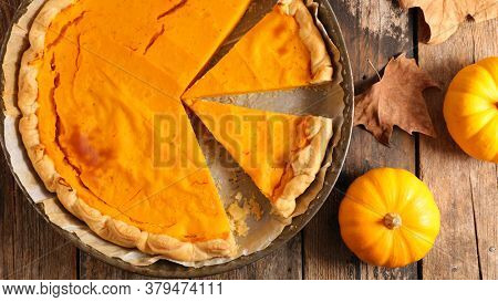 pumpin pie on wood background