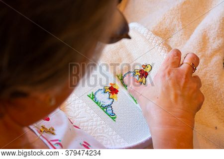 A Woman Creating A Colorful Cross Stitch Design For A Child Theme. Concepts Of Manual Work Or Work A