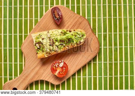 Toasted Baguette, Bruschetta With Avocado And Tomato.