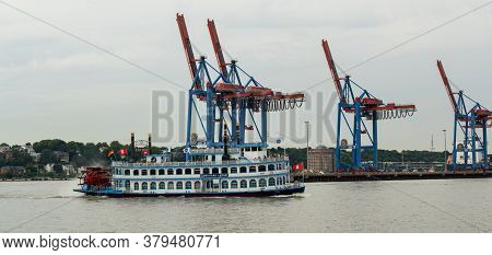 Hamburg, Germany - August 01, 2020: Louisiana Star Rear Wheel Steamer Drives In Front Of The Contain