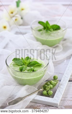 Chilled Green Pea Puree Soup With Tender Milk Cream And Refreshing Mint