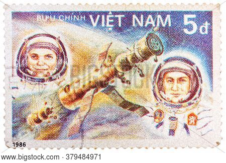 Vietnam - Circa 1986. A Stamp Printed In Vietnam Shows Vietnam Cosmonaut Pham Tuan And Soviet Cosmon