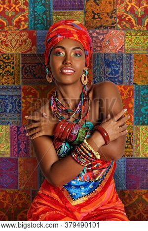 Portrait Of A Young And Attractive African American Black Woman In The National African Clothes Agai