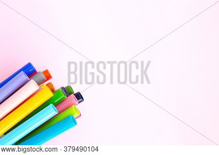 Colorful Marker Pen Set On Pink Background. Vivid Highlighters And Blank Space For Your Design Or Mo