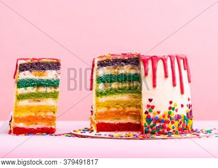 Rainbow Cake. Bright Different Colors Of Layers. Unusual Cake. A Layer Of Caramel Sponge Cake Succes
