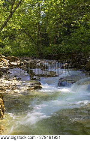 Fast  Cascade Mountain Stream Flow Among Stones. Beautiful Nature Of Carpathians. Ukraine. Europe. S