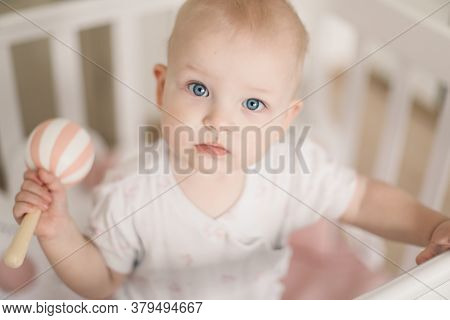 Baby Playing With A Toy. Adorable Cute Little Baby Girl Playing With Toys At Home Or Nursery. Happy