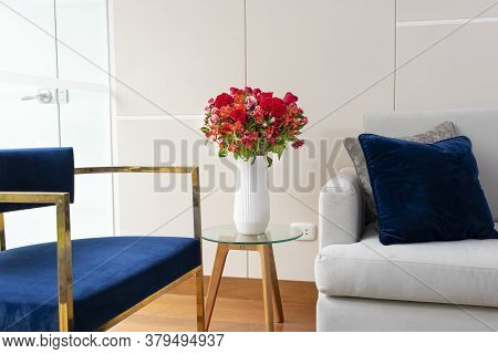 Flower Arrangement Of Red Roses In A Nice Living Room