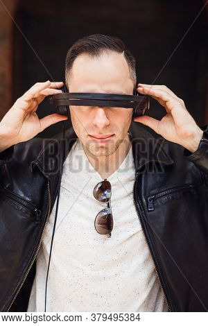 Close Up Of Portrait Of Man With Headphone Instead Of Glasses. Dj In Black Jaket With Black Glasses