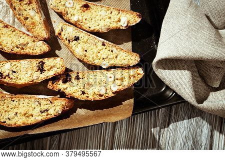 Italian Biscotti Cookies On Black Baking Sheet. Fresh Baked Cookies With Nuts And Dried Cranberries.