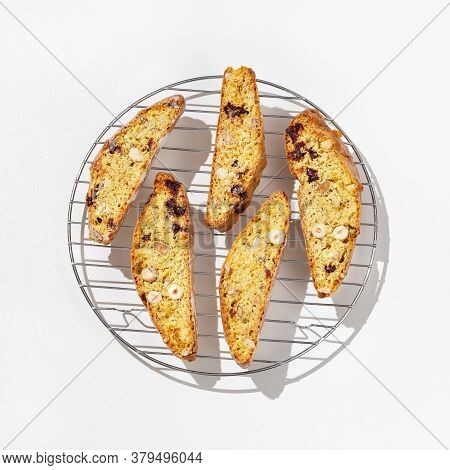 Italian Biscotti Cookies On Baking Rack. Fresh Baked Cookies With Nuts And Dried Cranberries.