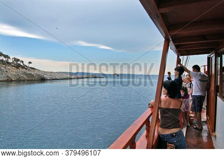 Tourists On An Old Boat In Greece