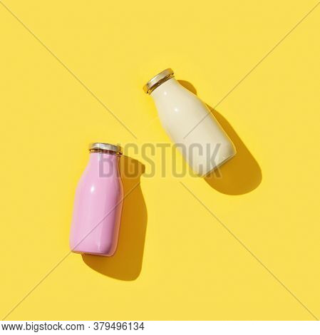 Two Small Glass Bottles For Juice Or Yogurt, Packaging Template Mock Up On Yellow Colored Background