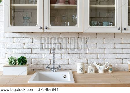 Element Of White Kitchen In Apartment With Modern Interior, Sink And Water Tap, Kitchenware Supplies