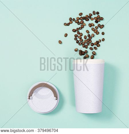 Reusable Eco Coffee Cup And Roasted Coffee Beans. Shopping At Coffee Shop. Social Media Content.