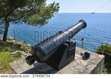 Rovinj, Croatia - May 22, 2020: View Of The Adriatic Sea And An Old Cannon, Rovinj, Croatia