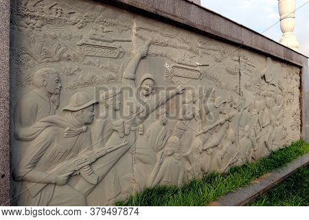 Hoi An, Vietnam, February 29, 2020: Mural In Relief Depicting A Battle Of The Vietnam War In The Mar