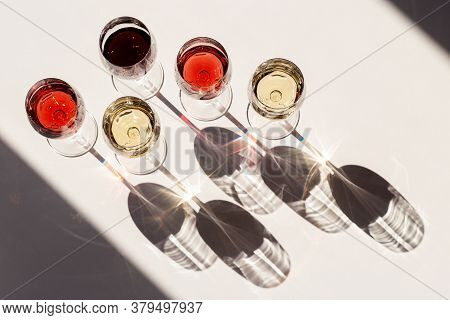Red, Rose And White Wine Top View In Sunlight. Assorted Wine In Glass. Dark Shadows