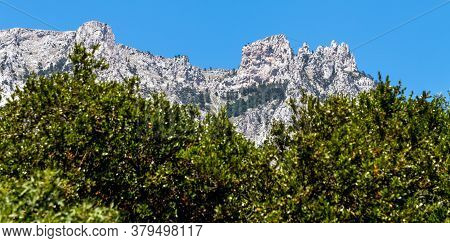 Battlements Of Ai-petri Mountain Against The Background Of Treetops, Crimea