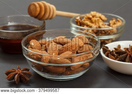 Health Remedy Foods For Cold And Flu Relief With Almond Nuts, Honey, Dried Cloves And Star Anise On