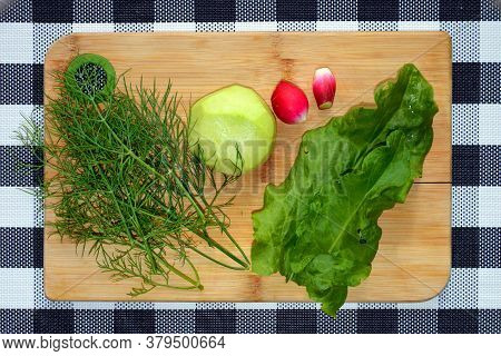 The Salad Ingredients Are On The Cutting Board. Clean Vegetables - Dill, Kohlrabi Cabbage, Lettuce,