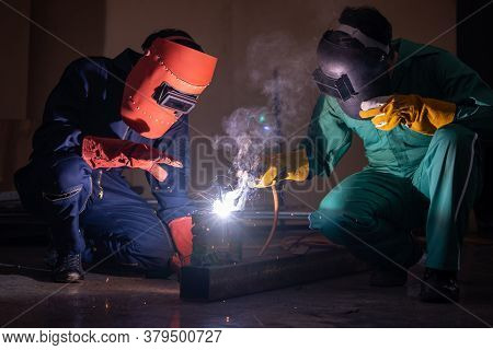 Metal Welding Steel Works Using Electric Arc Welding Machine To Weld Steel At Factory. Metalwork Man