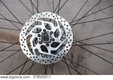Part Of Mountain Bike Brake Disc In Close Up. Close-up Disc Brake Bicycle Wheel. Chrome Steel Bushin