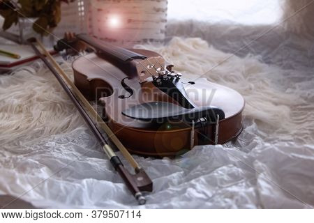 Violin And Bow On Grunge Surface Background,prepare For Practice,blurry Light Around,lens Falre Effe