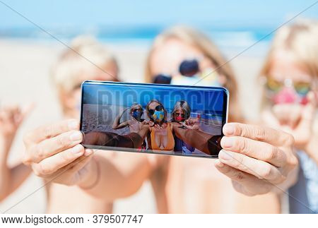 Funny Kids With Mother Taking Selfie Photo By Smartphone On Tropical Sea Beach. Rule To Wear Face Co