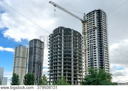 Multi Storey Residential Building. Windows And Walls In House Under Construction. Modern Civil Engin