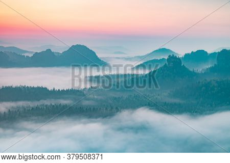 Colorful Morning With  Kleiner Winterberg Silhouettes, Saxon Switzerland, Germany. Misty, Rocky.