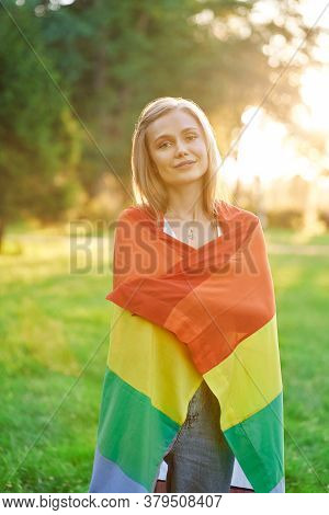 Stunning Caucasian Girl Holding Rainbow Lgbt Flag On Shoulders, Looking At Camera And Smiling, Summe