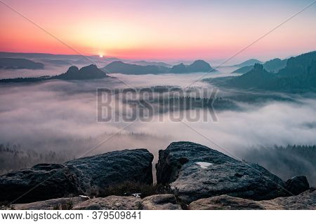 Misty Morning On Sandstone Cliff In Saxon Switzerland National Park. Colorful Spring Sunrise In Germ