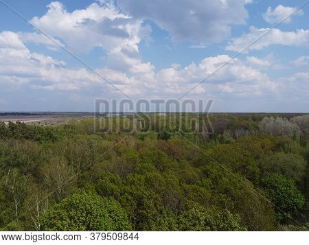 Blue Cloudy Skies Over A Dense Forest, Aerial View. Beautiful Cloudy Sky Over The Forest.