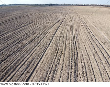 Plowed Agricultural Field, Aerial View. Agricultural Land.