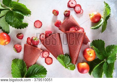 The Natural Sweetness Of Strawberries. Dainty And Berries On A Light Background With Strawberry Leav