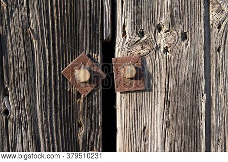 Untreated Vertical Wood Plank Boards And Rusty Metal Pins Close Up. Natural Wood Texture For Backgro