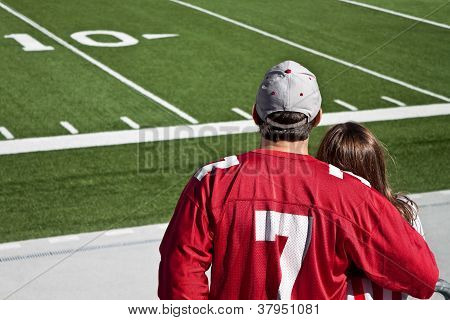 American football fans at field with copy space poster
