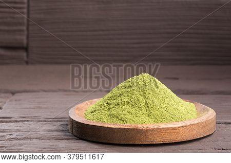 Stevia Sweetener Powder - Stevia Rebaudiana. Wooden Background