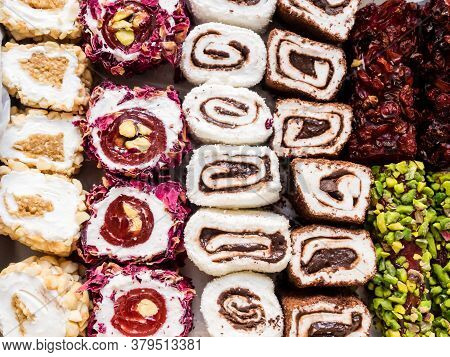 Turkish Delight With Nuts, Pistachios, Coconut, Chocolate And Rose Leaves. Rahat Lokum, Traditional