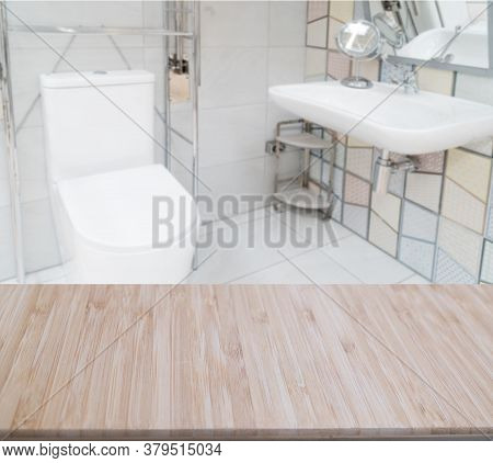 Wooden Counter Top On Blur Bathroom Background, Ror Montage Product Display Or Key Visual Layout.