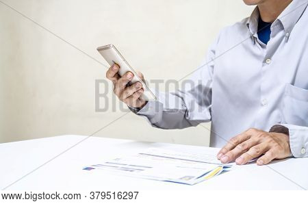 Businessman Holding So Many Expenses Bills Such As Electricity Bill, Water Bill,internet Bill,cell P