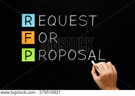 Hand Writing Rfp Request For Proposal Business Concept With White Chalk On Blackboard.