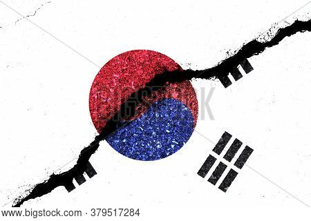 Japan And South Korea Flag On Cracked Wall Damage.now Both Countries Have Economic And Patriotic Con