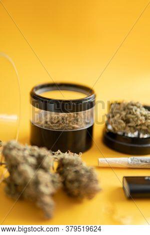 The Pot Leaves On Buds. Sativa Thc Cbd. Cannabis Nature Bud. Marijuana Weed Bud And Grinder.
